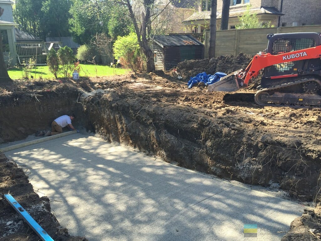Landscaping, fiberglass pool installation, and cedar fence.