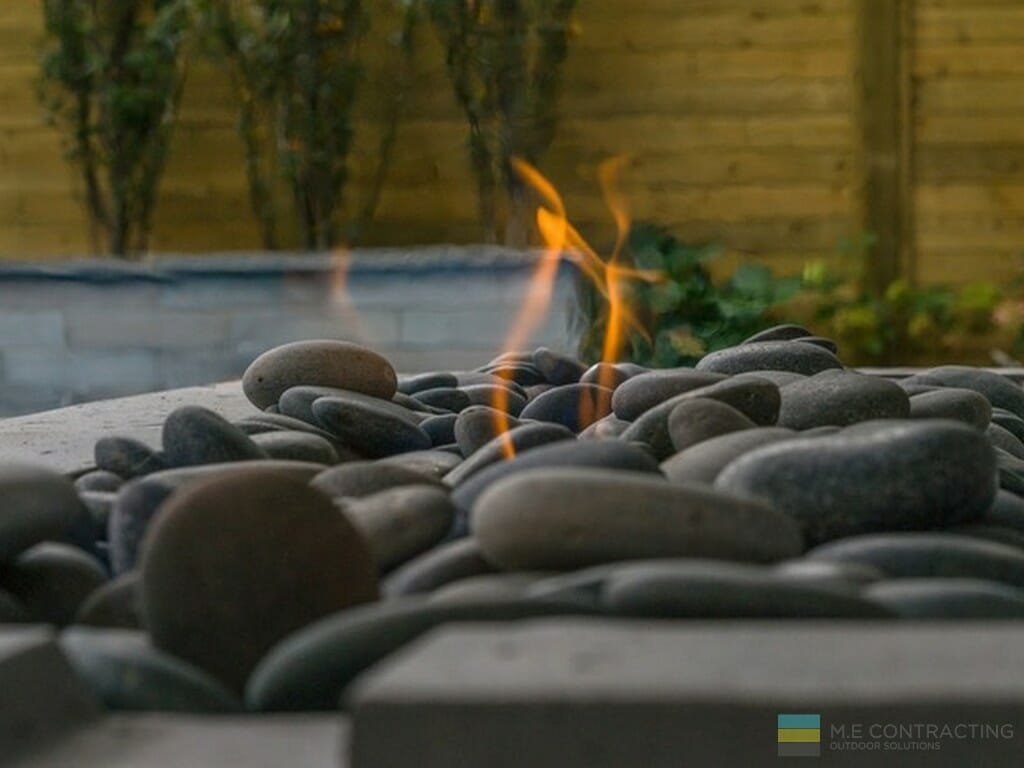 Stone fire pit and cedar fence