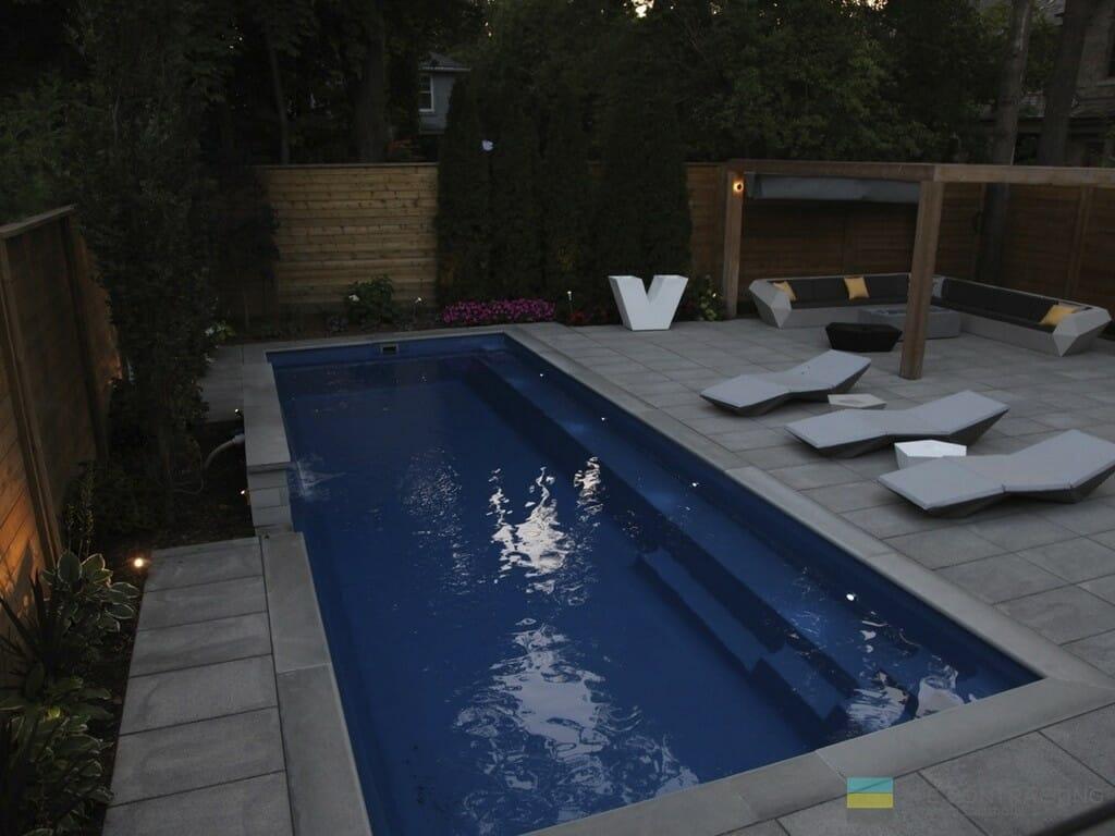 Landscaping with fiberglass pool, cedar fence, cedar pergola and stone patio.