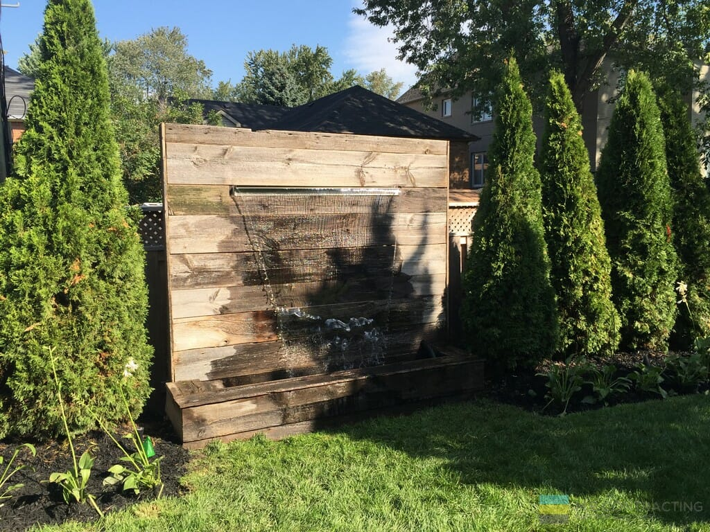 Landscaping, water feature, horizontal cedar privacy screen