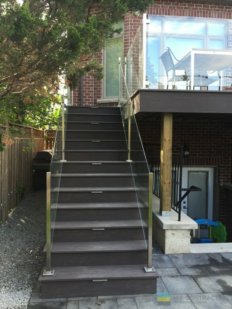 Interlocking, PVC deck and steps, tempered railings with stainless steel posts and clips.
