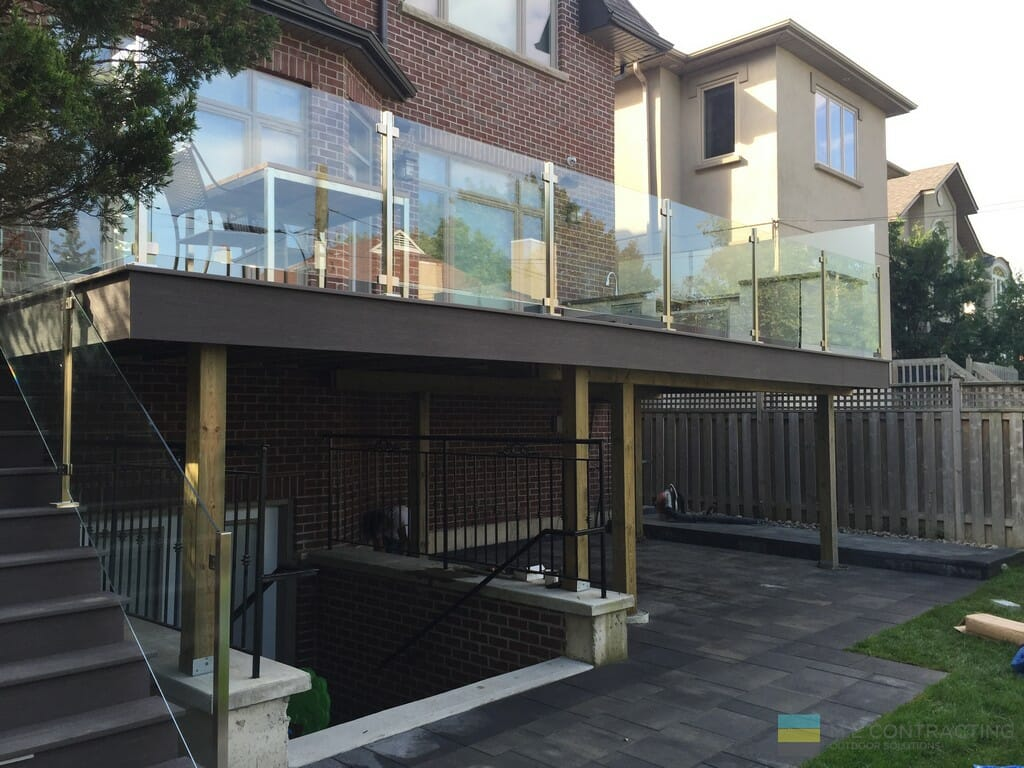 M.E. Contracting interlocking, PVC deck and steps, tempered glass railings with stainless steel posts and clips
