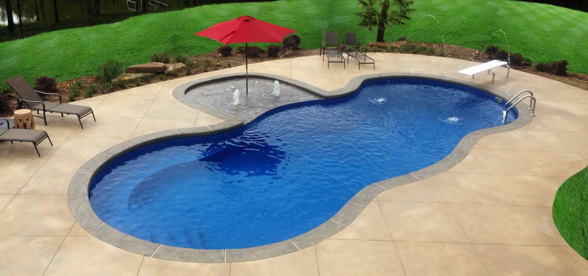 Mediterranean Fibreglass Pool with water feature and coping by Leisure Pools