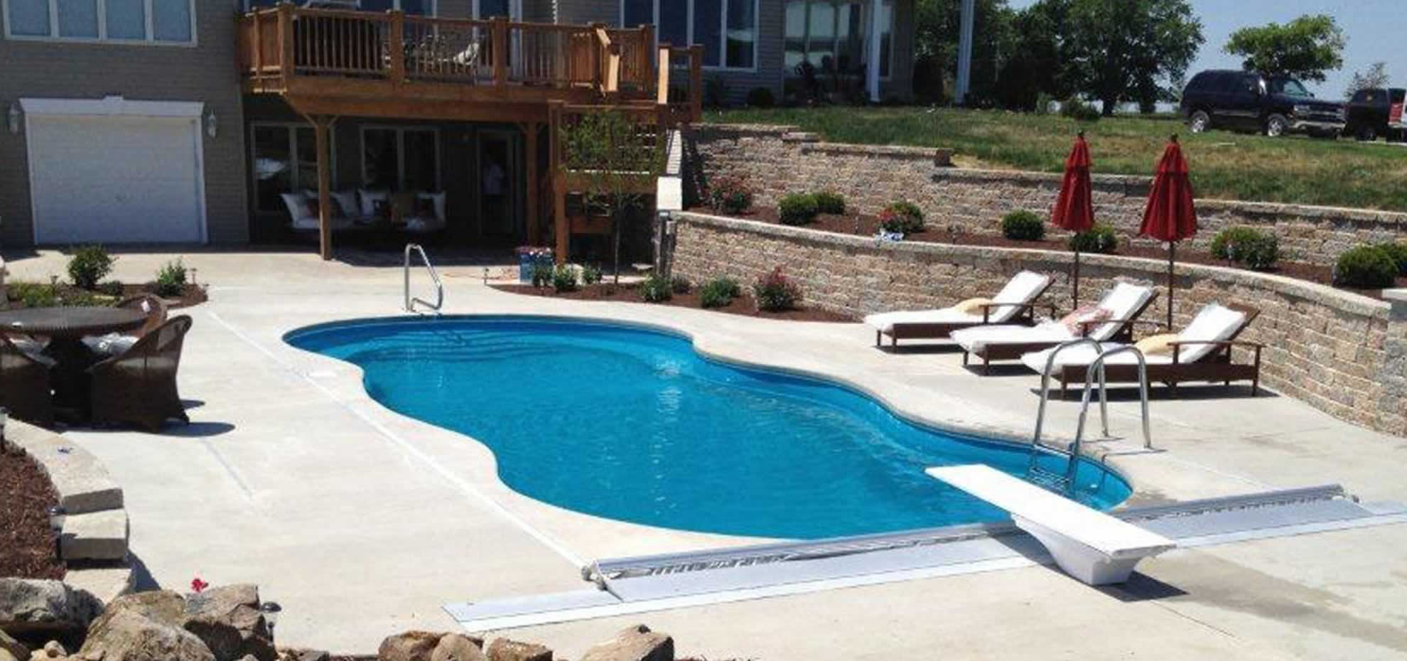 Mediterranean fibreglass pool design with coping by Leisure Pools