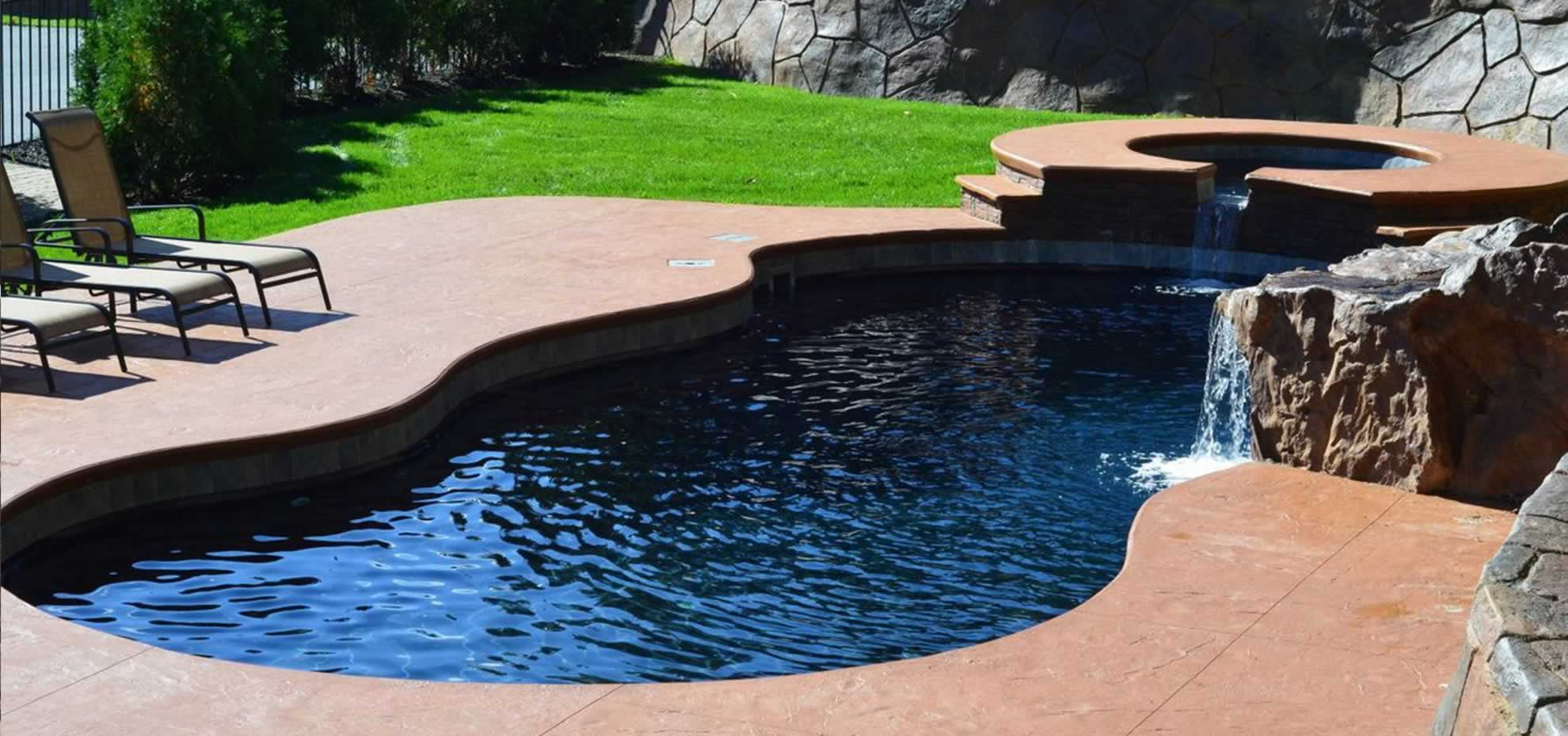 Mediterranean Fibreglass pool with water features and coping by Leisure Pools