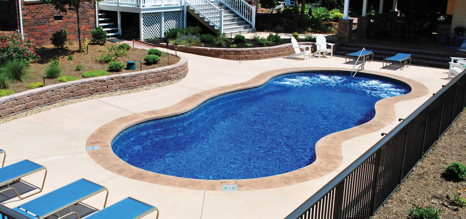 Mediterranean fibreglass pool with coping by Leisure Pools