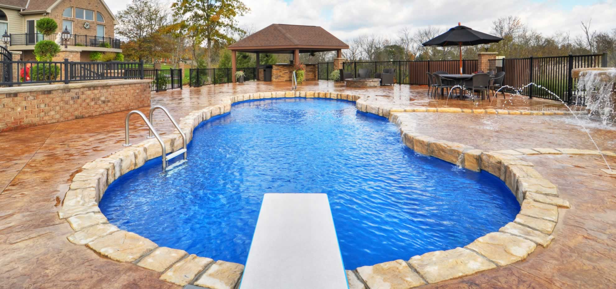 Mediterranean Fibreglass Pool design with water feature and coping by Leisure Pools