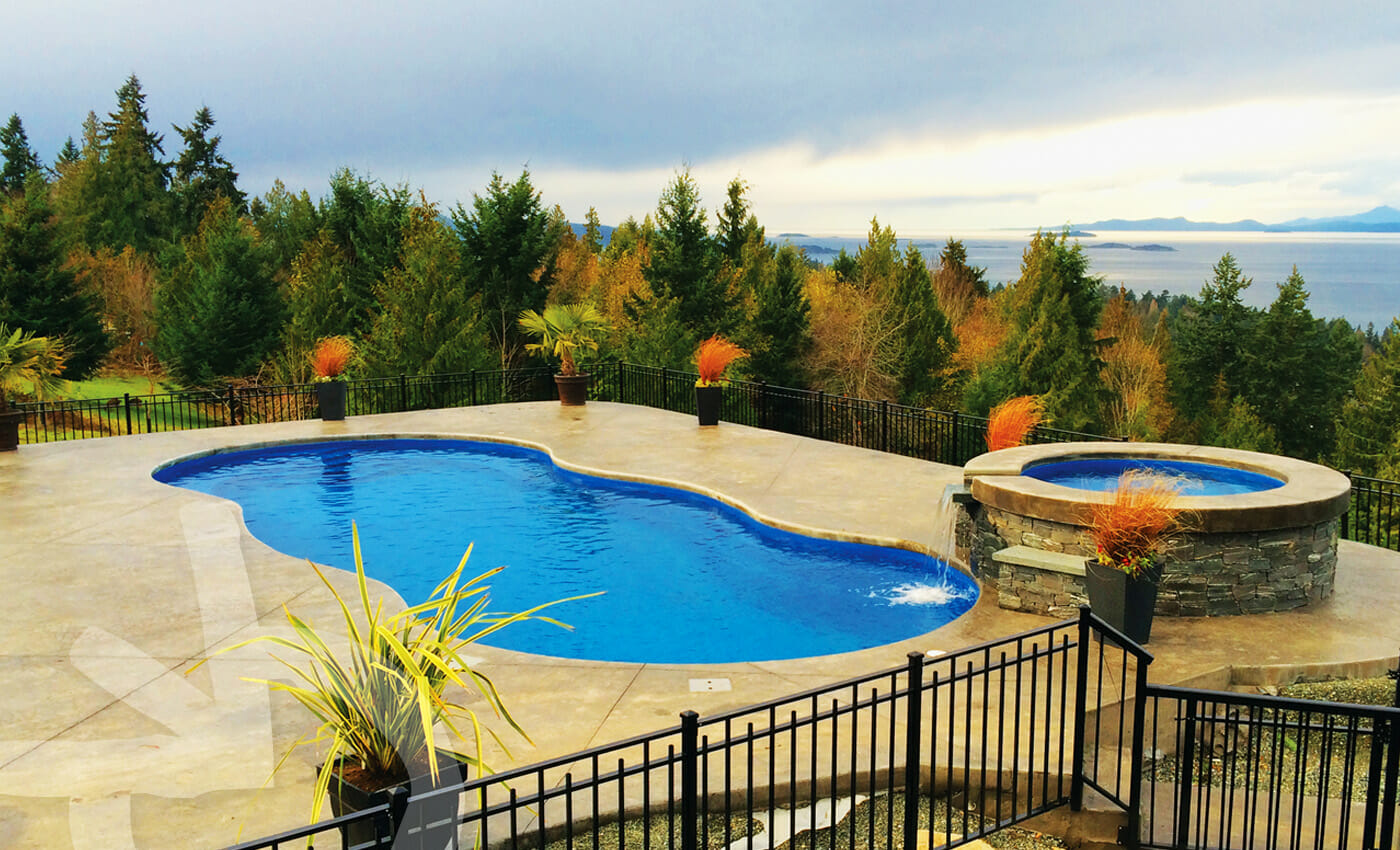 Fibreglass Pool with Mediterranean design and water feature by Leisure Pools