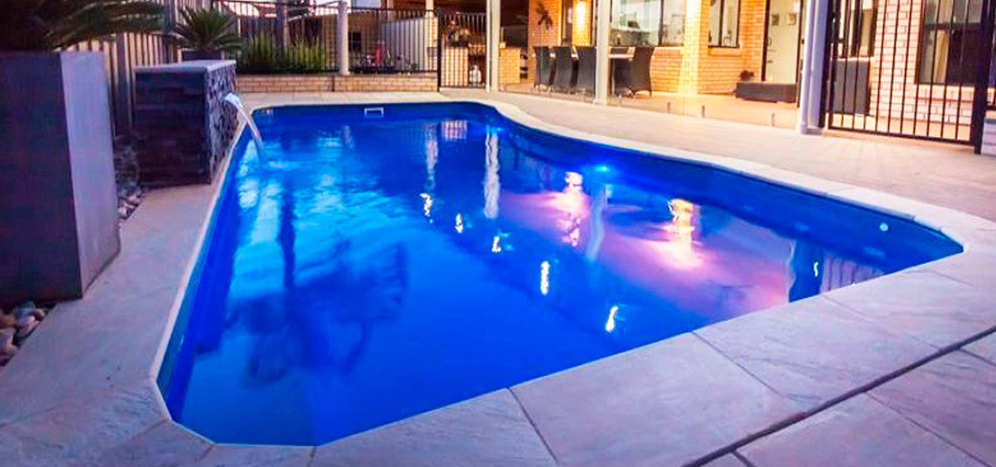 Moroccan Fibreglass Pool design with stone water feature and coping by Leisure Pools