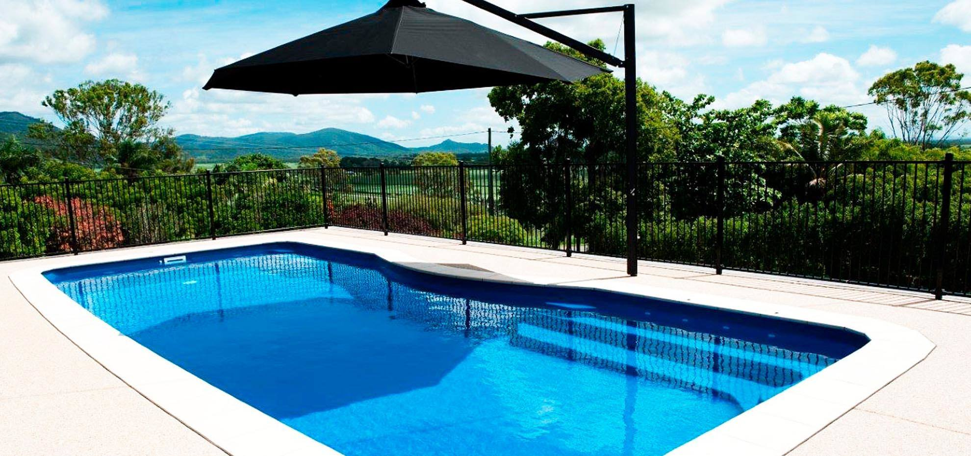 Moroccan fibreglass pool design with coping and shade umbrella by Leisure Pools