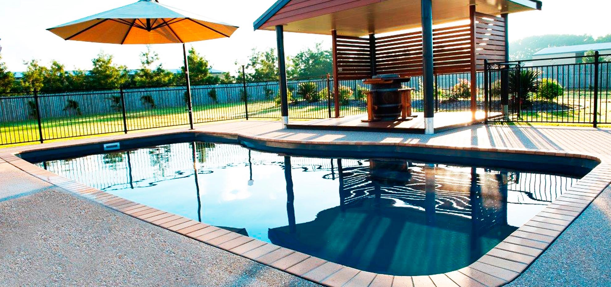 Moroccan Fibreglass Pool with pergola and coping by Leisure Pools