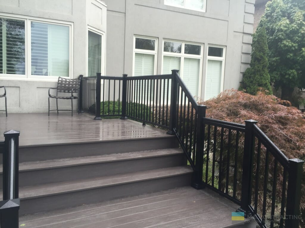 PVC deck, aluminum railings, landscaping, interlocking,