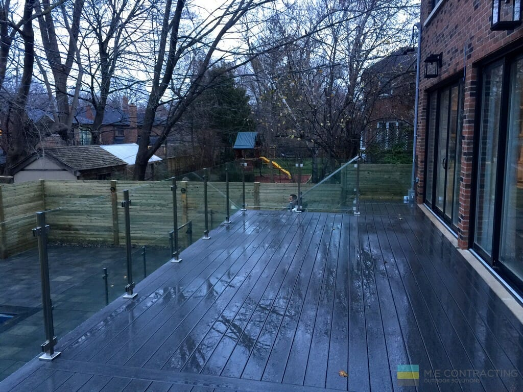 PVC deck with stairs, tempered glass railings, stainless steel posts and clips, interlocking, gate, cedar fence, stone venner
