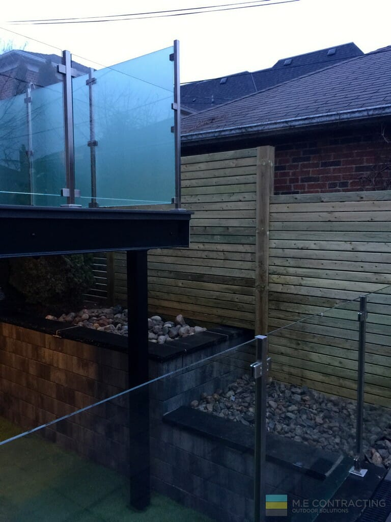 PVC deck, stairs, tempered glass railings, stainless steel posts and clips, interlocking, gate, cedar fence, stone pebble, artificial grass