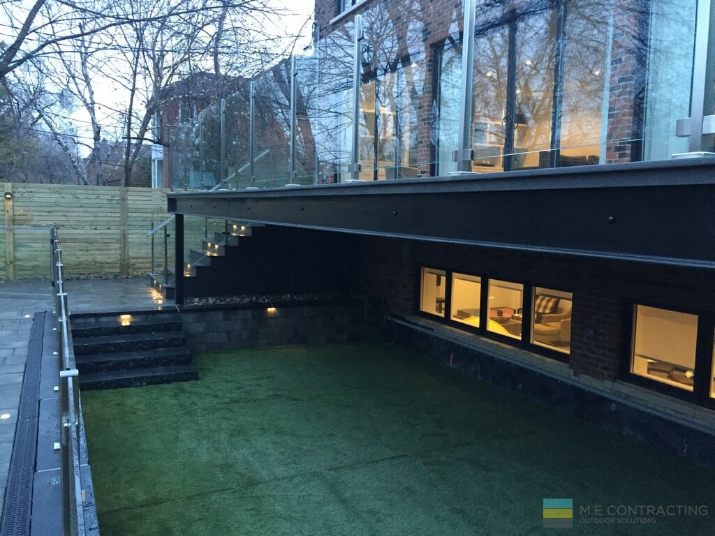 PVC deck, stairs, tempered glass railings, stainless steel posts and clips, interlocking, gate, cedar fence, stone veneer, artificial grass
