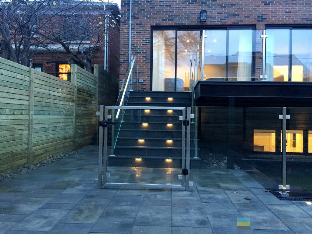 PVC deck, stairs, tempered glass railings, stainless steel posts and clips, interlocking, gate, cedar fence