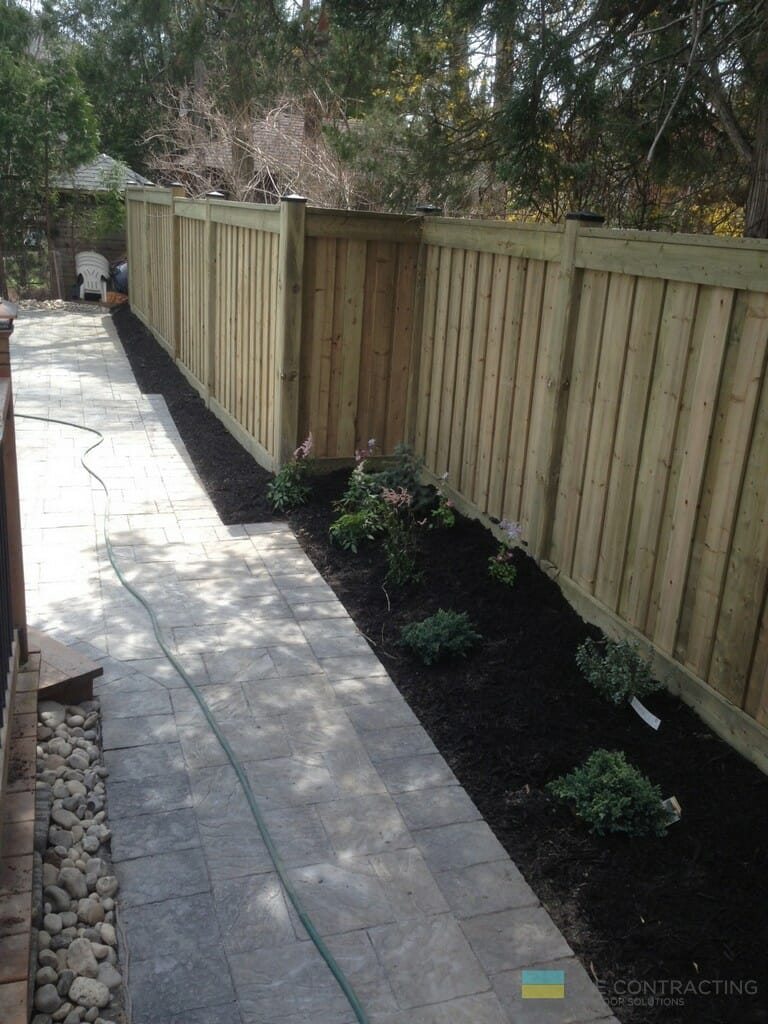 Cedar fence, landscaping and interlocking