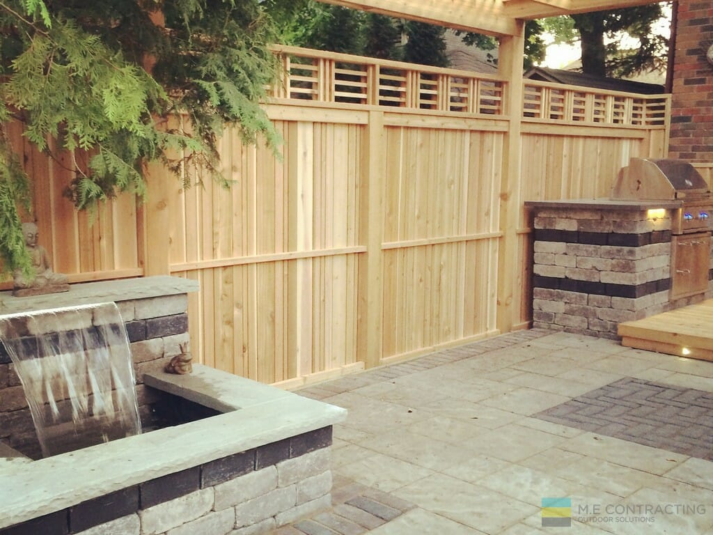 Cedar fence with interlocking and fountain