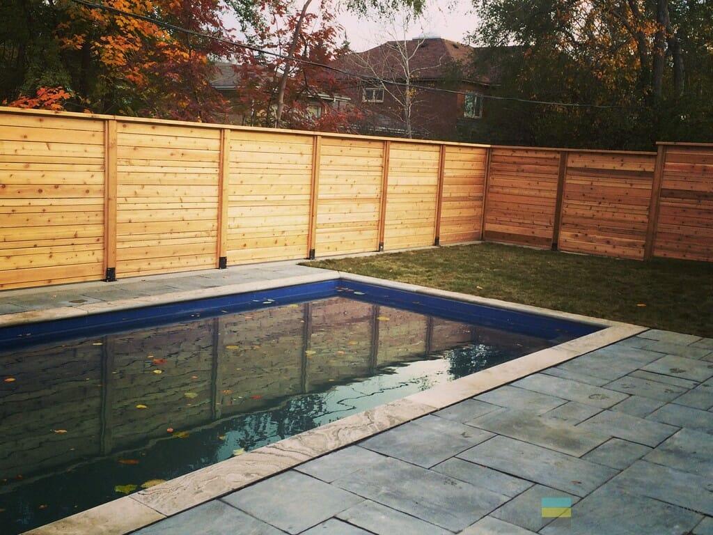 Interlocking, pool and cedar fence