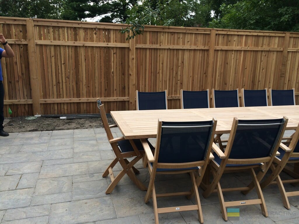 Interlocking patio and cedar fence and table