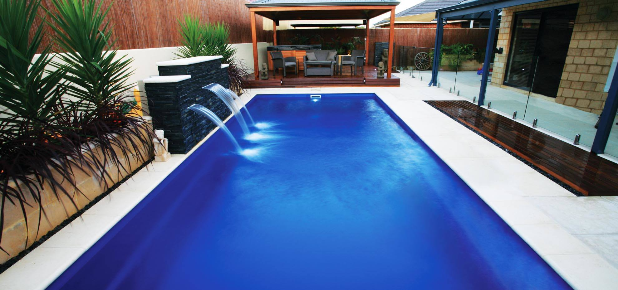 The Reflection Fibreglass pool with coping, pergola and water feature by Leisure Pools