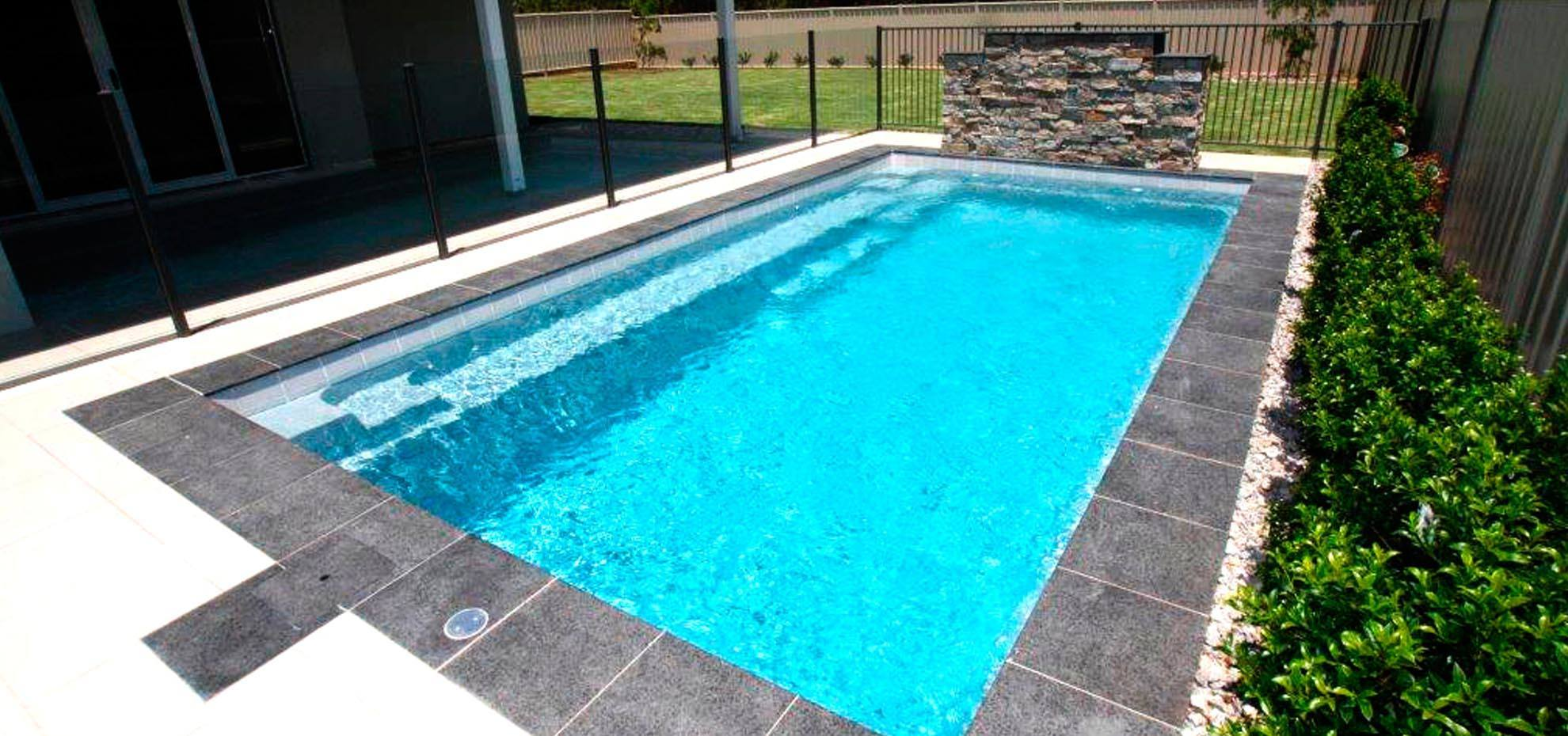 Reflection Fibreglass pool with coping and water feature by Leisure Pools