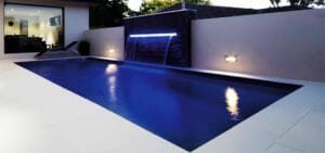 The Reflection Fibreglass pool with coping and water feature by Leisure Pools