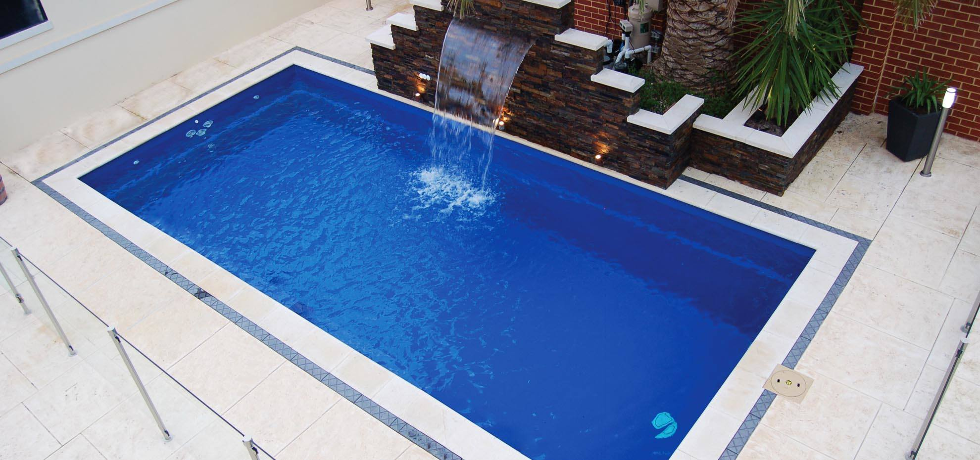 Reflection Fibreglass pool with water feature and coping by Leisure Pools