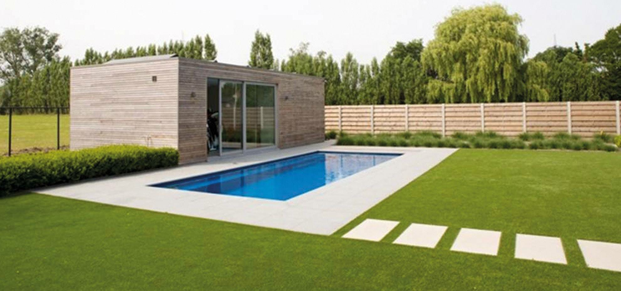 Reflection Fibreglass pool with coping and pool house by Leisure Pools