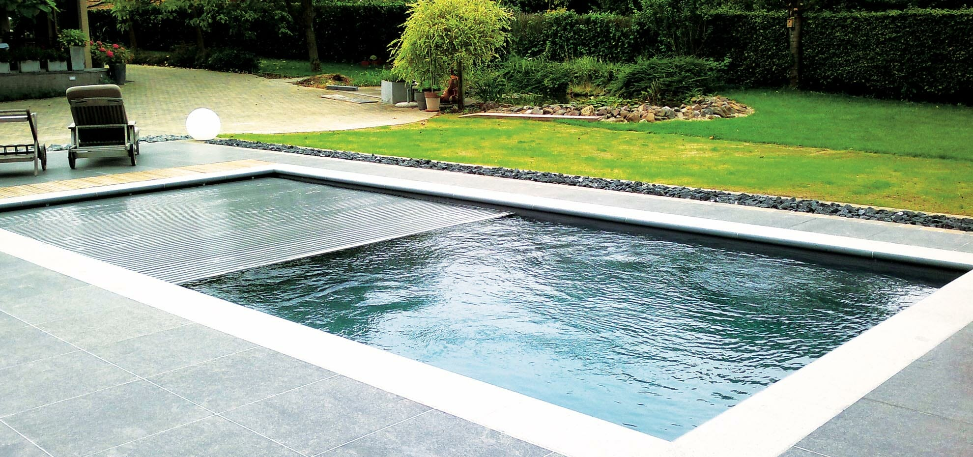 The Reflection with Auto Cover and coping stone by Leisure Pools