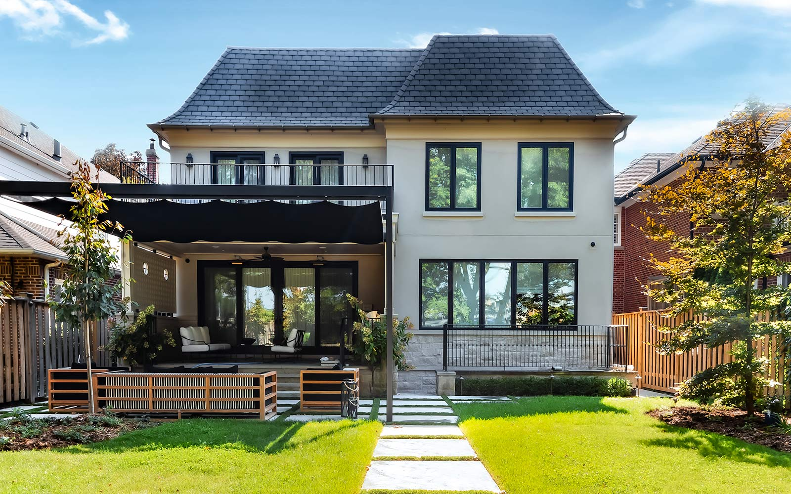 Complete Landscaping Project by Toronto Landscaping Company; Featuring Retractable Pergola, Interlocking, Privacy Fence, Outdoor Fireplace & Outdoor Kitchen.