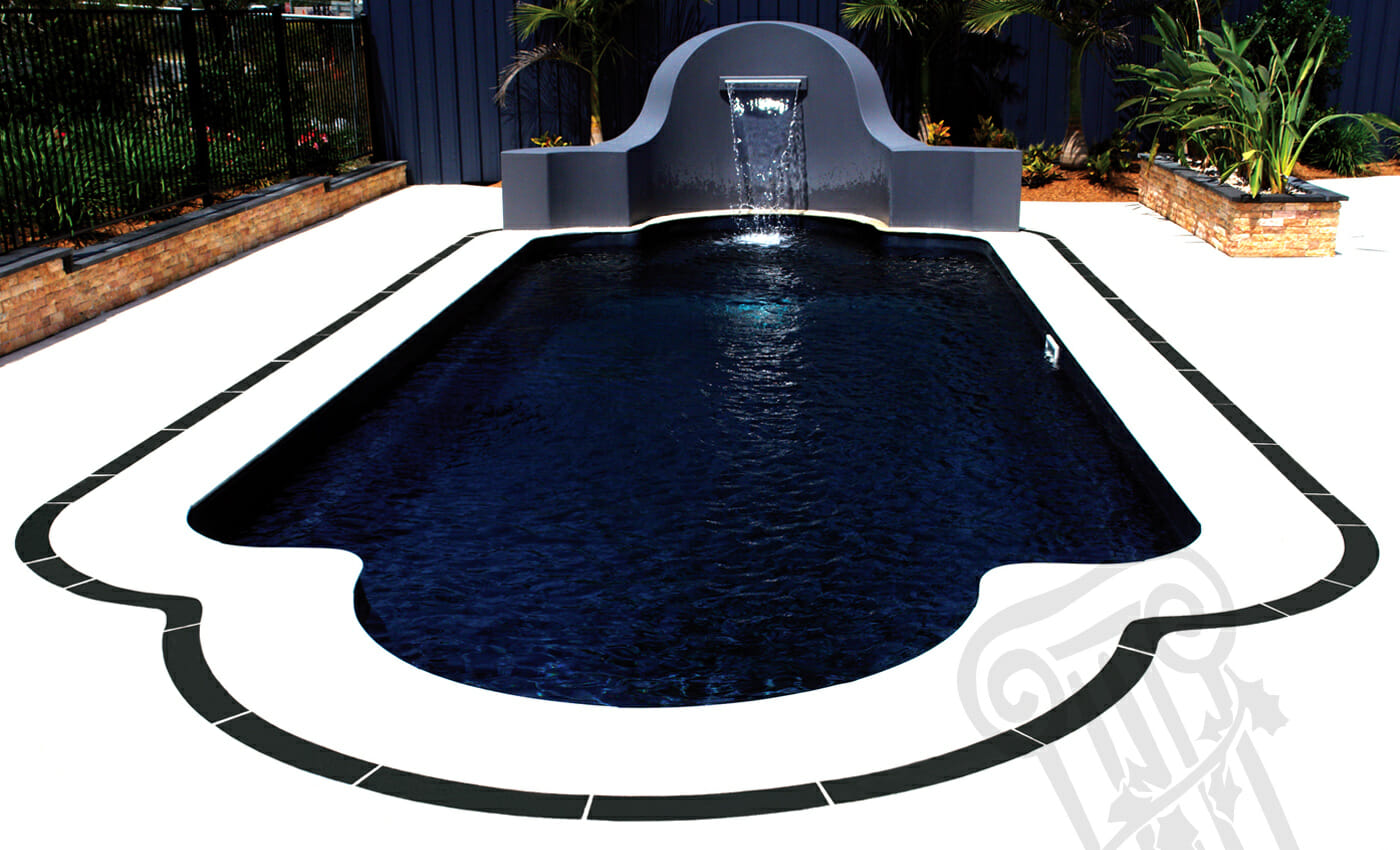 Roman Fibreglass pool with coping by Leisure Pools