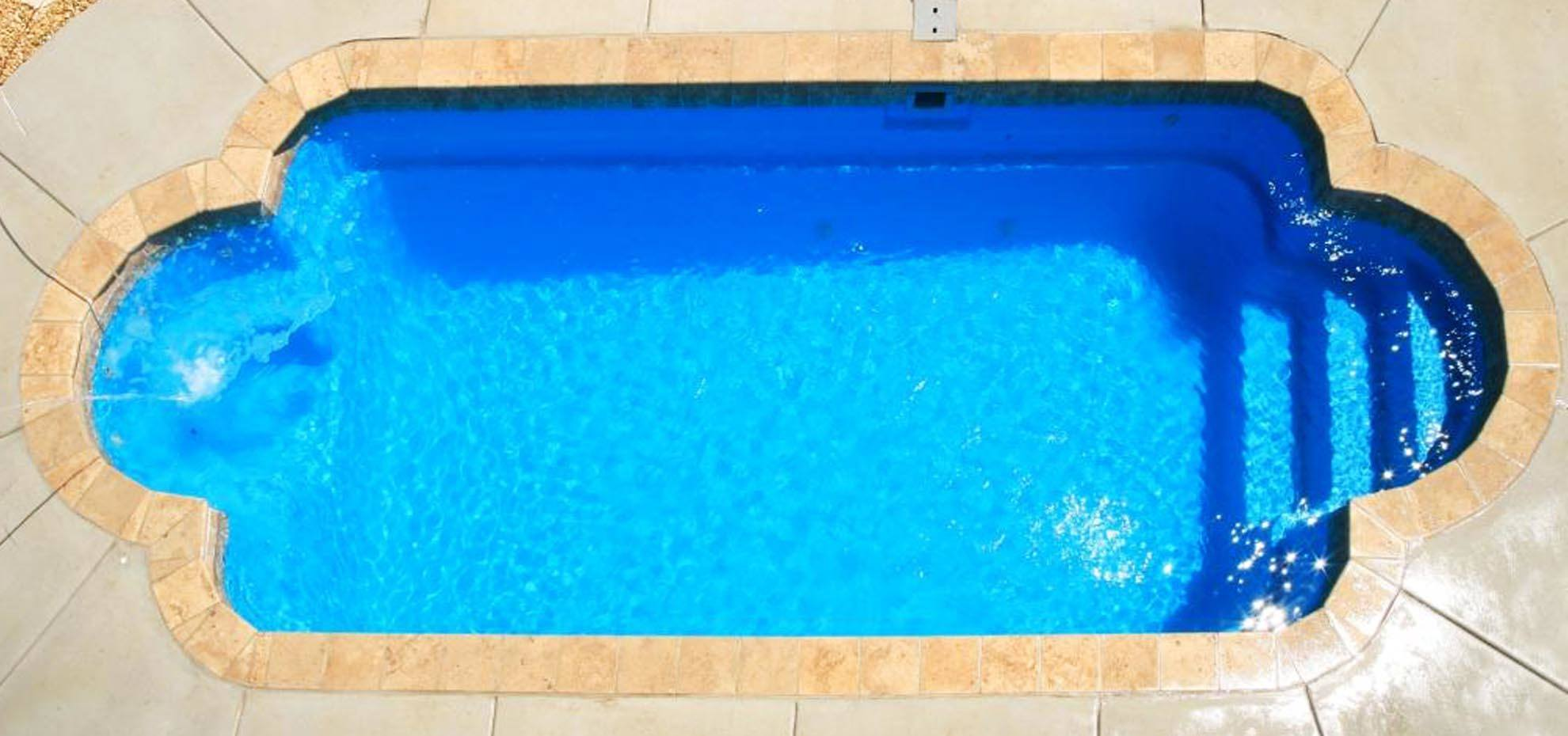 Roman style fibreglass pool with coping by Leisure Pools