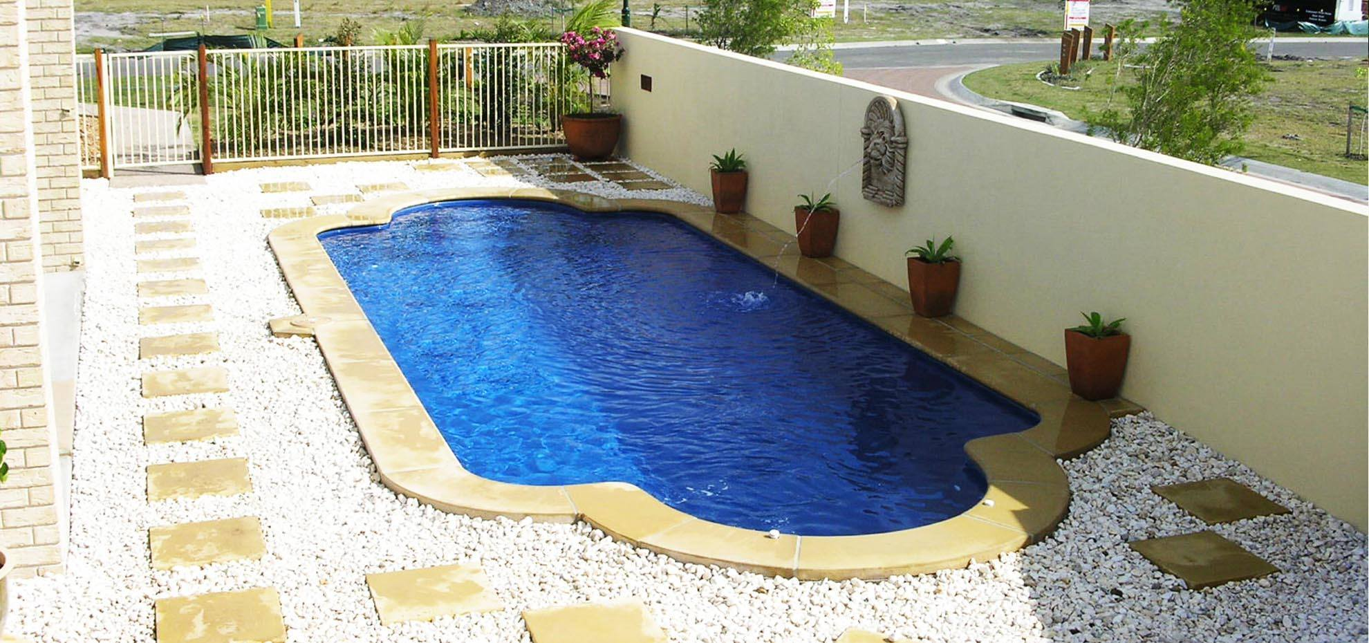 Roman Fibreglass pool with water feature and coping by Leisure Pools