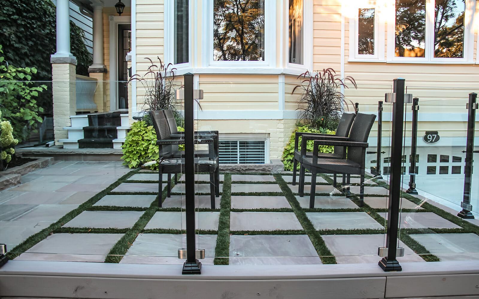 Toronto Front Yard Interlocking & Aluminum Glass Railings Project by The Toronto Landscaping Company.