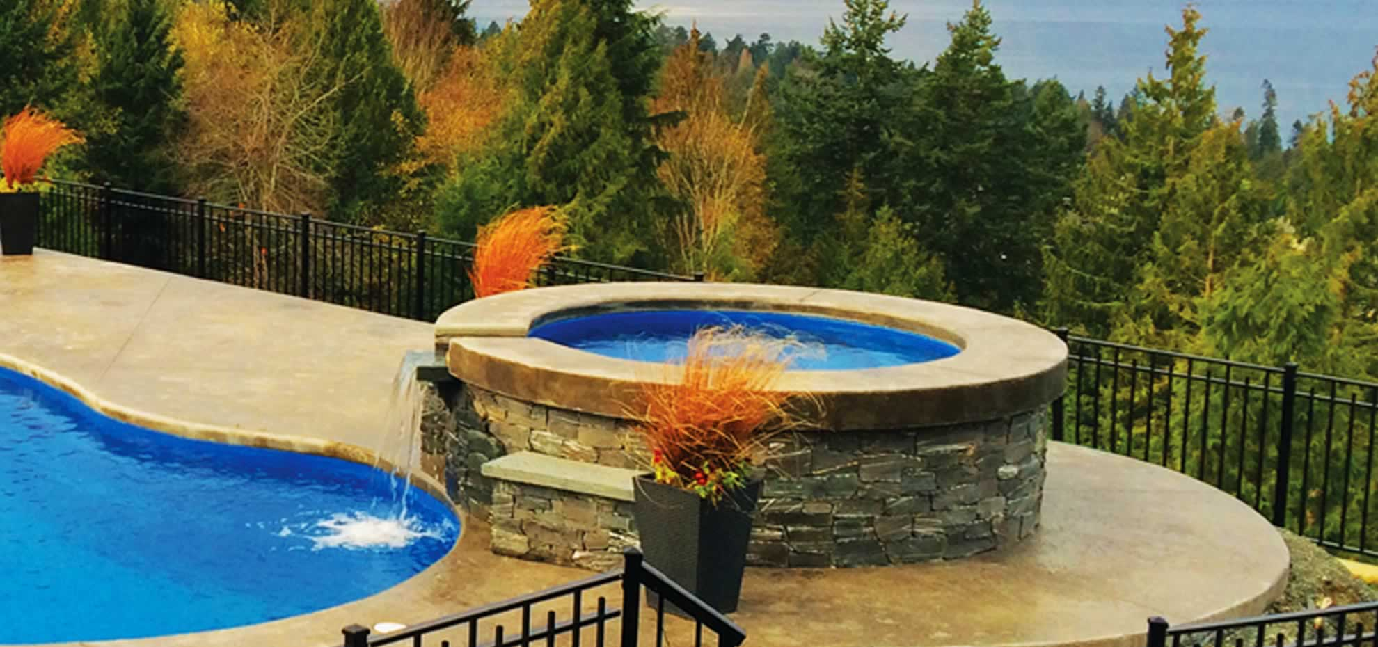 Elevated Circular Fibreglass pool with water feature by Leisure Pools