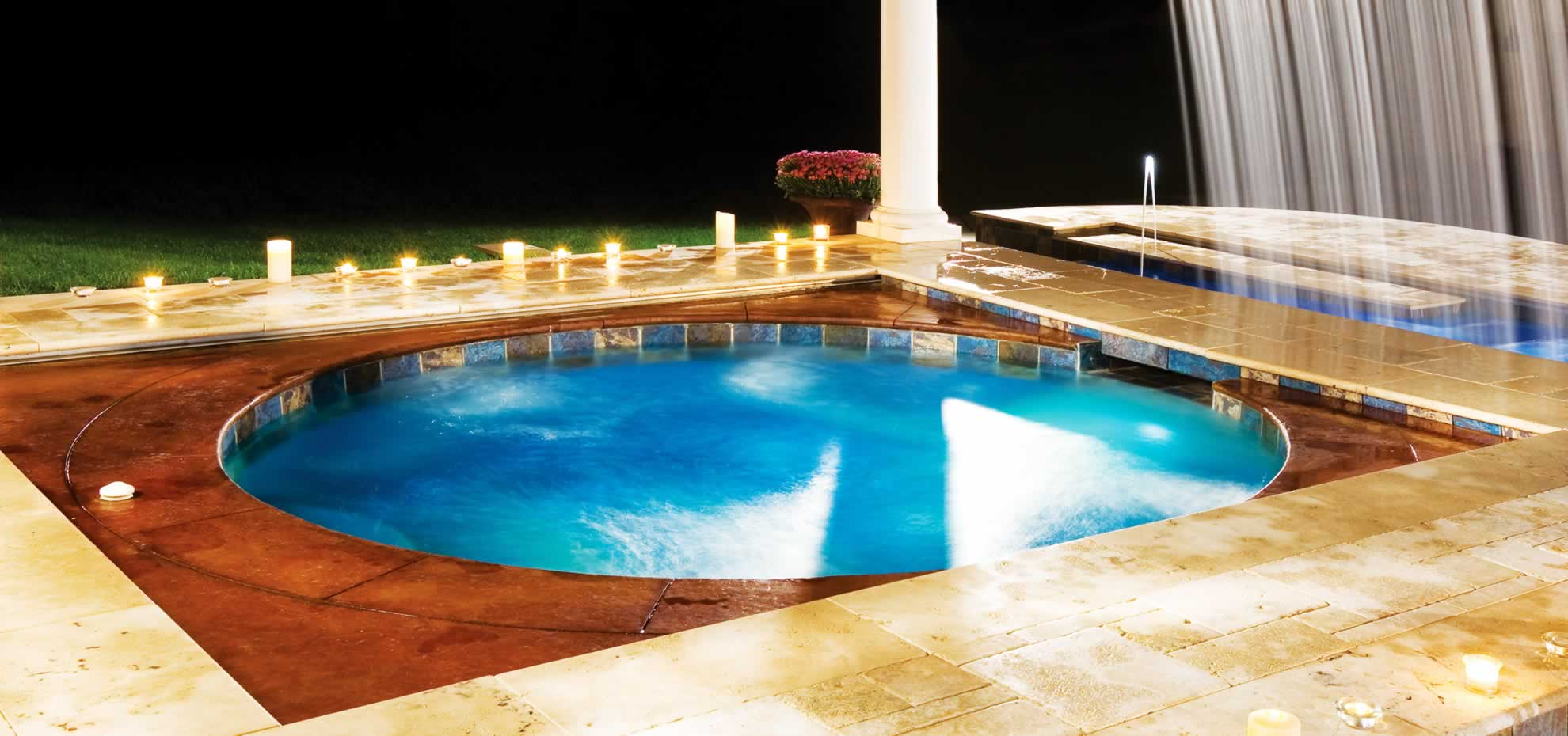 Fibreglass pool with coping and lighting by Leisure Pools