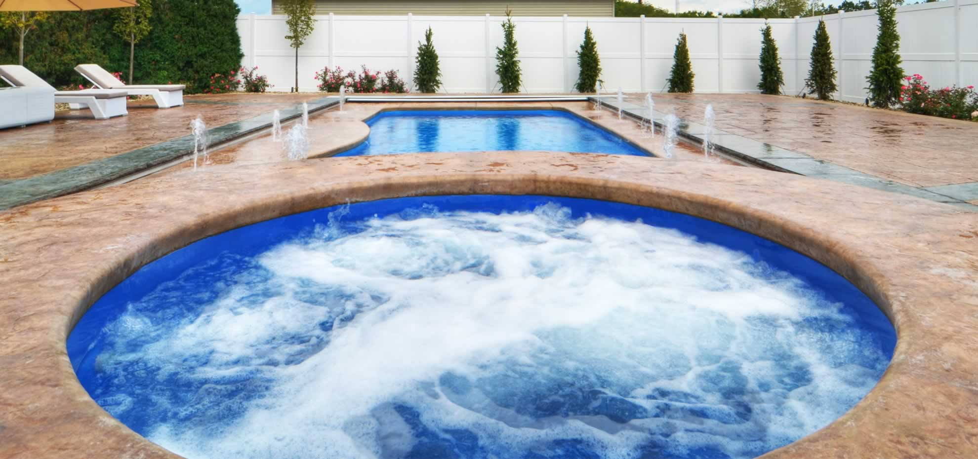 Fibreglass pool with coping by Leisure Pools