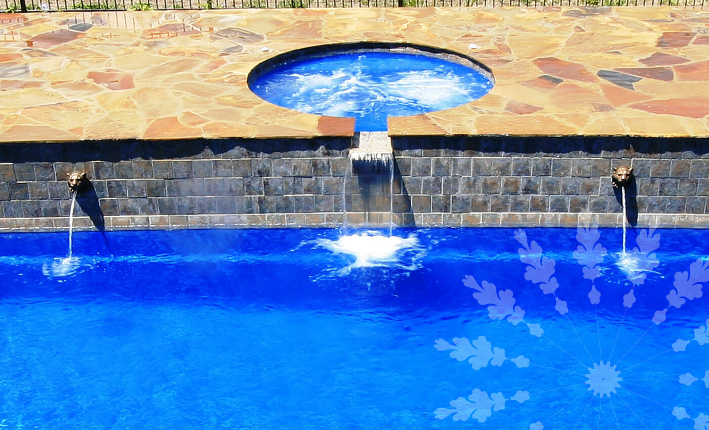 Fibreglass pool with water feature and coping by Leisure Pools