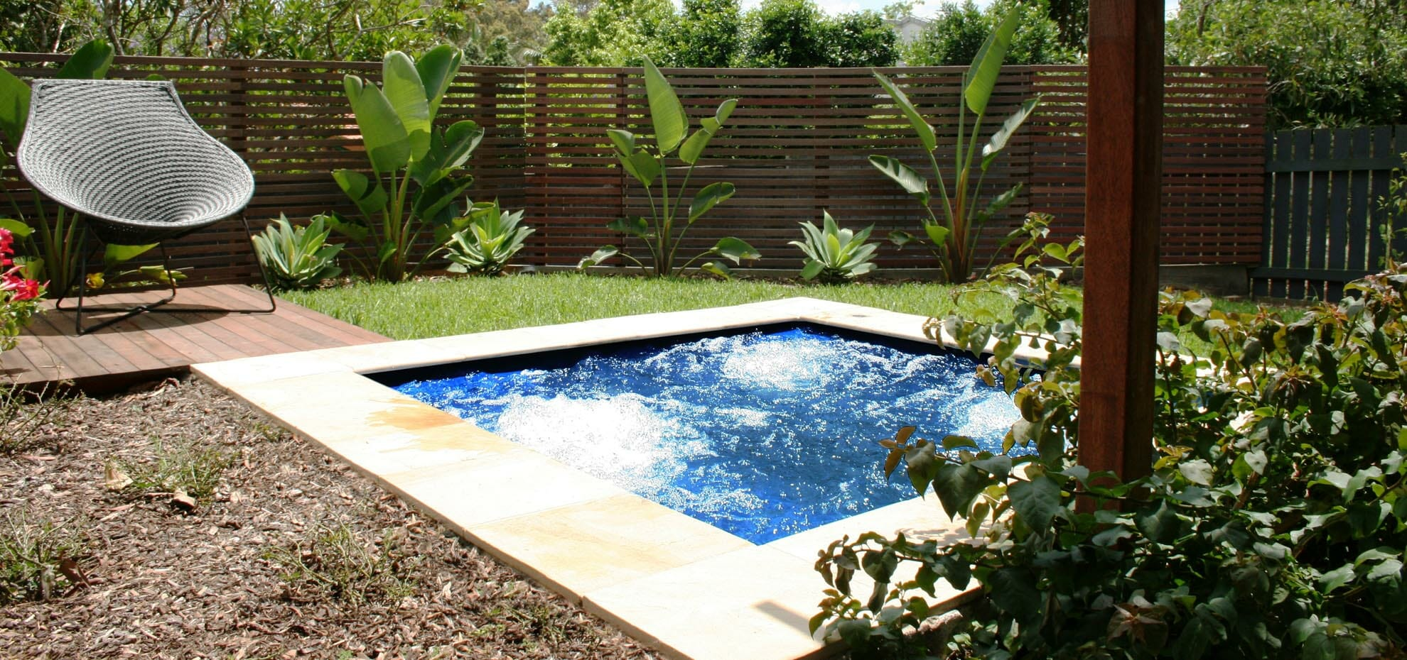 Sorrento Fiberglass pool with coping stone by Leisure Pools