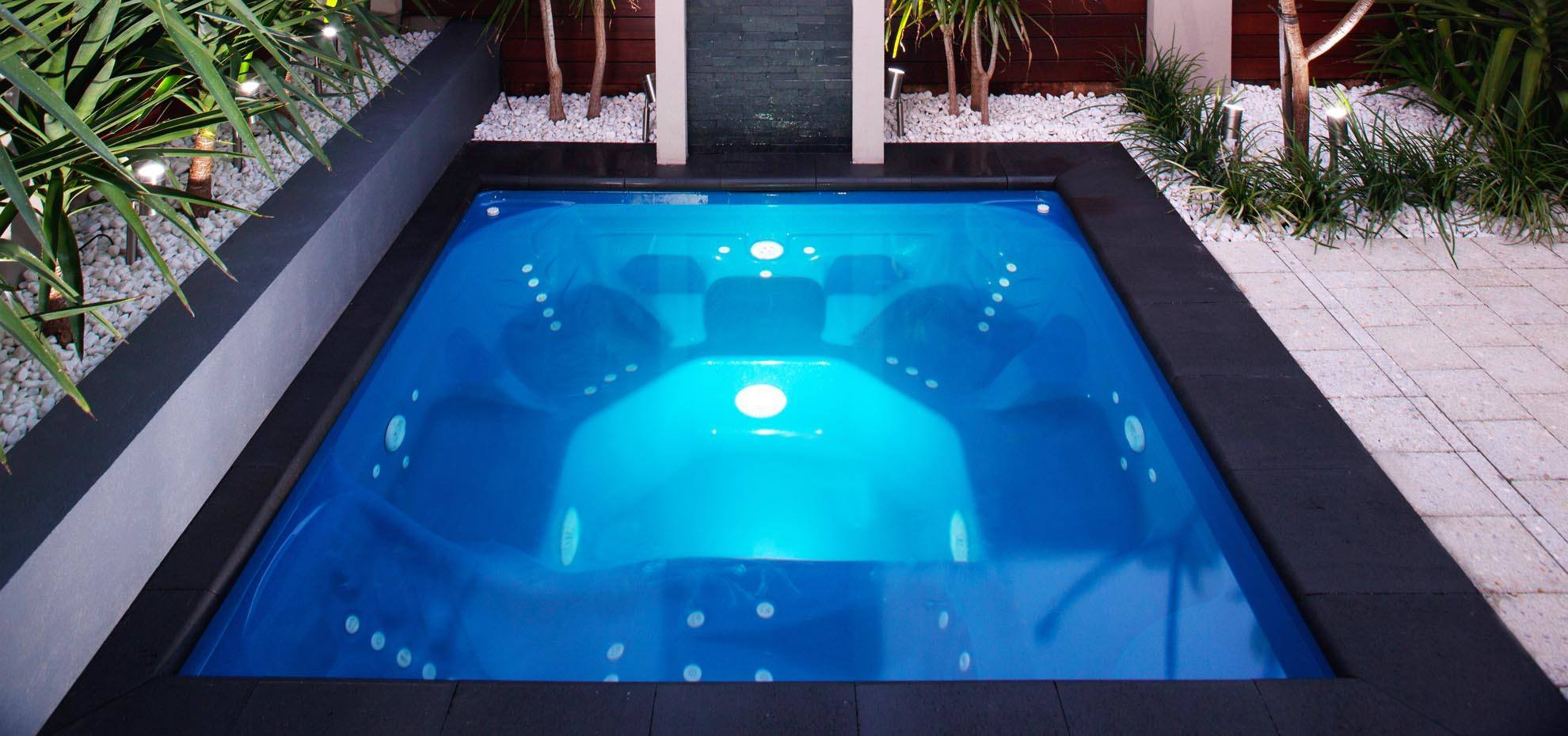 Sorrento Fibreglass pool with coping and lighting by Leisure Pools