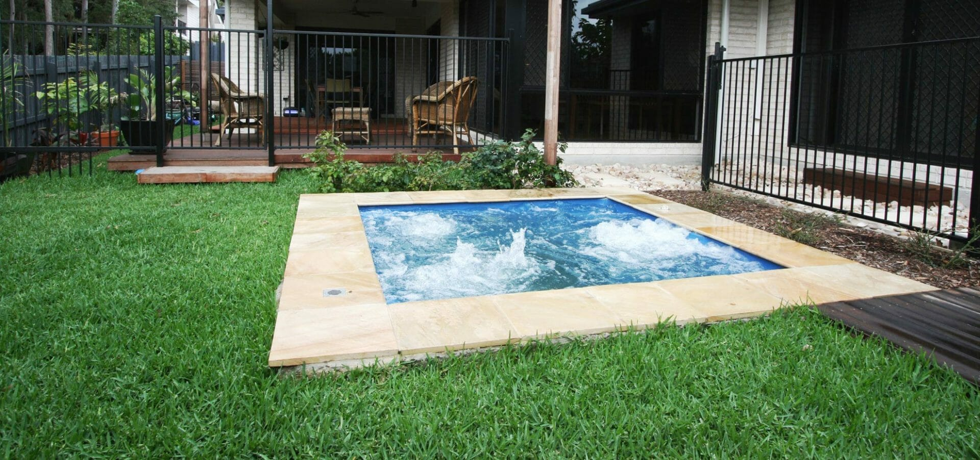 Fiberglass pool with coping stone by Leisure Pools
