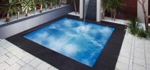 Sorrento Fiberglass pool with water feature and coping by Leisure Pools