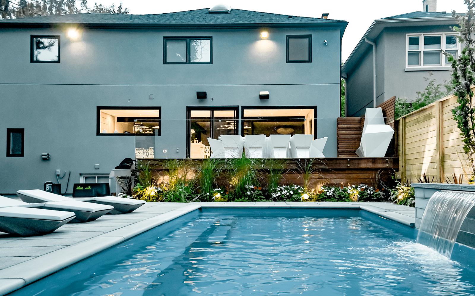 Sekler Residence, Complete Toronto Backyard Landscape Design Project with Fiberglass Pool Installation and Water Feature, Interlocking, Cedar Fence, Composite Decking, Frameless Glass Railings & Interlocking by Toronto Landscaping Company.