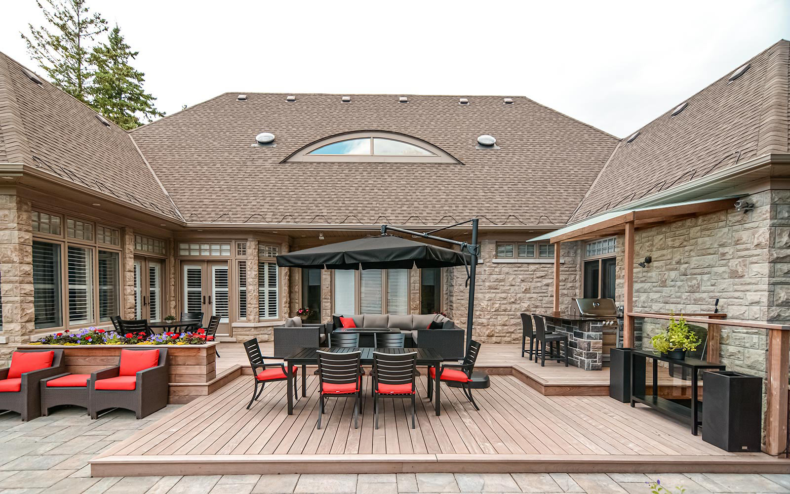 Toronto Landscaping Company Decking & Interlocking Project; Featuring IPE Decking, IPE Privacy Fence, Woodworking Pergola.