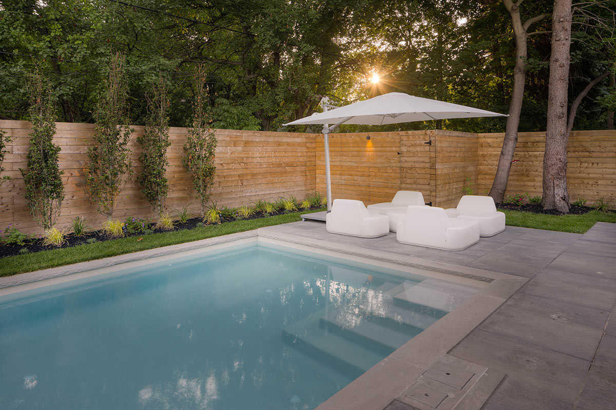 Toronto Landscape Design with Concrete Pool & Privacy Fence Installation by M.E. Contracting