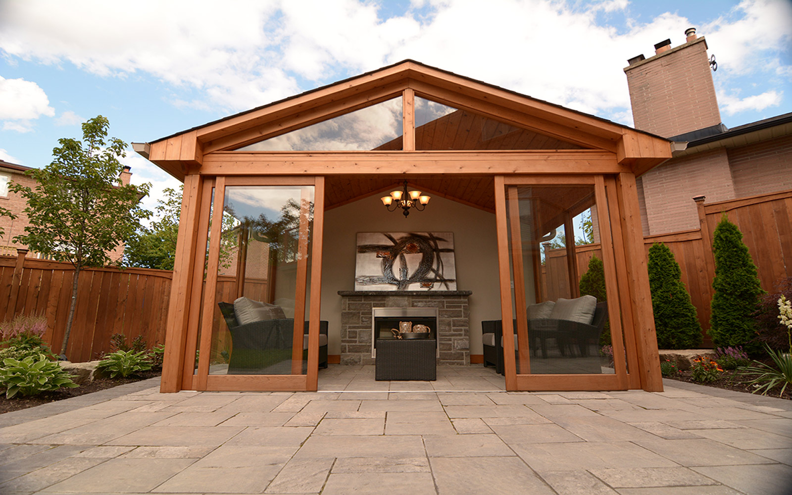Toronto Landscaping Project; Featuring Gazebo, Interlocking, Cedar Privacy Fence & Outdoor Fireplace by The Best Toronto Landscaping Company.
