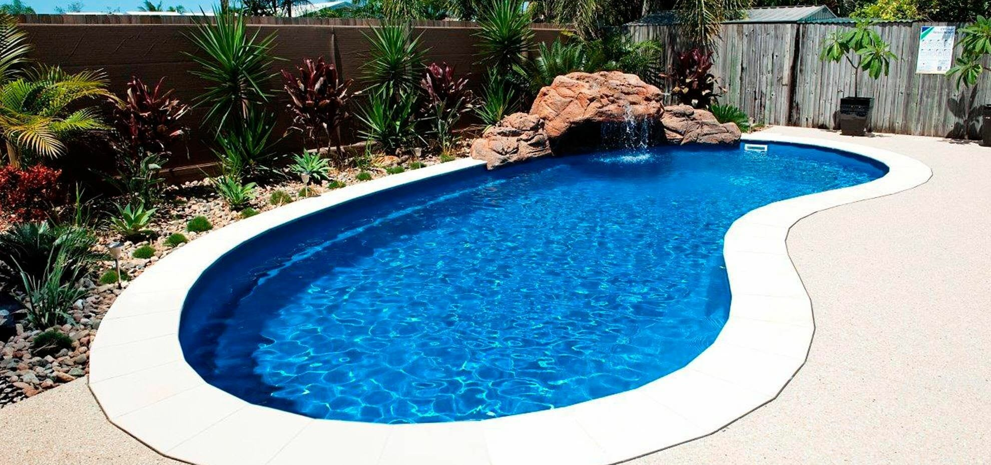 Tuscany Fiberglass Pool with cedar deck by Leisure Pools