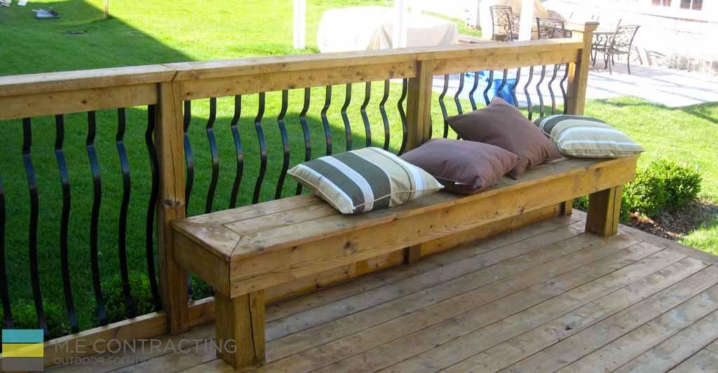 Pressure treated deck with pergola, stone veneer, pressure treated frame railings with aluminum