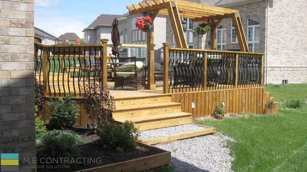 Landscaping, pressure treated deck and pergola, stone pebbles, skirting, stone veneer